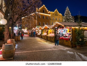 The colorful christmas market in Vipiteno in the evening. Trentino Alto Adige, Italy.
