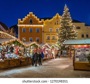 The colorful christmas market in Vipiteno in the evening. Trentino Alto Adige, Italy. December-15-2018