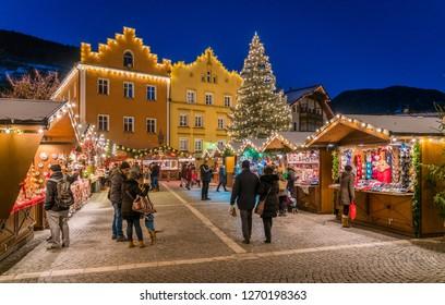 The colorful christmas market in Vipiteno in the evening. Trentino Alto Adige, Italy. December-15-2018