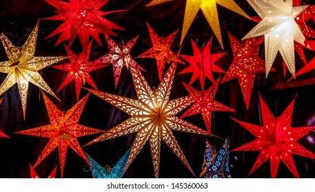 Colorful Christmas stars at a Christmas Market on black