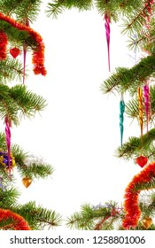 Colorful Christmas themed frame made from fir tree branches decorated with Christmas ornaments on white background