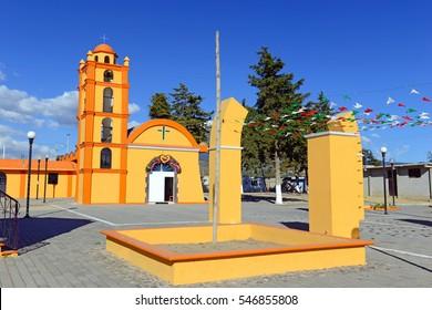 Colorful Church with blue sky background located near borders of Veracruz and Puebla, close to Pico de Orizaba, Iztaccihuatland Popocatepetl volcanoes, Mexico