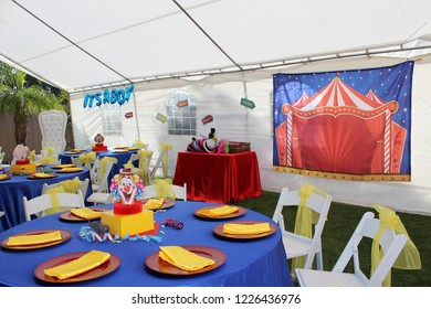 Colorful circus theme baby shower setup with photo booth