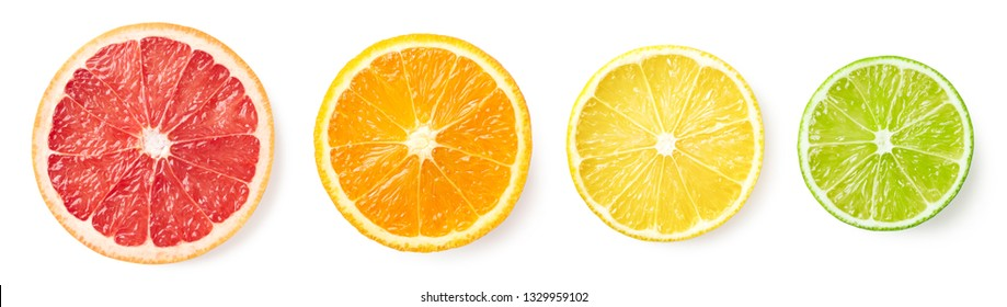 Colorful citrus fruit slices isolated on white background, top view. Grapefruit, orange, lemon and lime