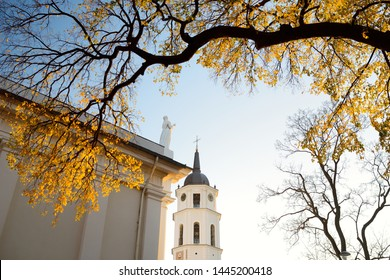 Colorful city park scene in the fall with orange and yellow foliage. Beautiful autumn scenery in Vilnius, Lithuania.
