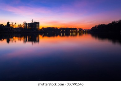 Colorful cityscape of Khmelnytskyi city at night, after sunset, along the river Southern Bug, beautiful Ukraine