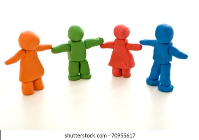Colorful clay people on white - unity in diversity or family concept