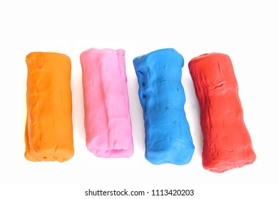 Colorful clay plasticine placed on white background.