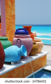 colorful clay pots with blue caribbean ocean