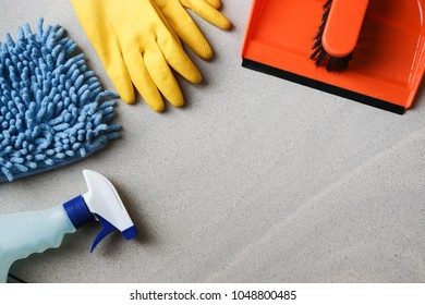 Colorful cleaning set for different surfaces in kitchen, bathroom and other rooms. Empty place for text or logo. Cleaning service concept. Early spring regular clean up. Top view.