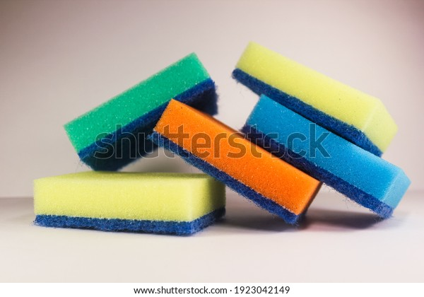 colorful-cleaning-sponges-stacked-on-600