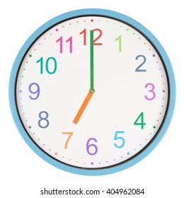 Colorful clock showing seven o'clock isolated on white background