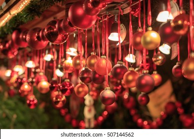 Colorful close up details of christmas fair market. Balls decorations for sales.