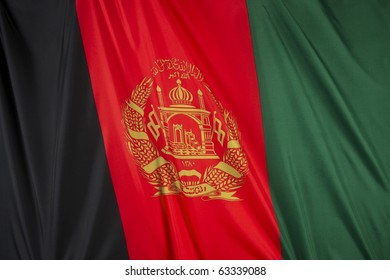 Colorful, closeup, wavy flag of Afghanistan fills the frame