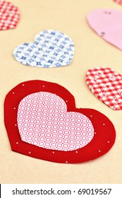 Colorful cloth hearts on a table