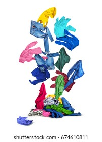 Colorful clothes falling on a pile of clothes, isolated on a white background.