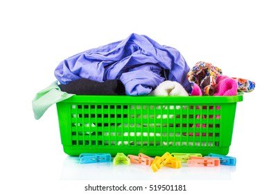 Colorful clothes in a laundry basket on white background