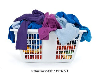 Colorful clothes in a laundry basket on white background. Blue, indigo, purple.