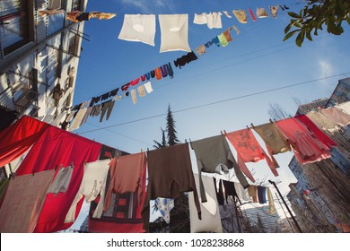 Colorful clothes laundry drying outdoor under sun and open sky  in line in Batumi city