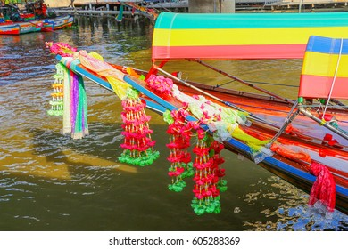 Colorful Clothes Tied To Bow Of Long tail Boat Bangkok Spirit in Thailand