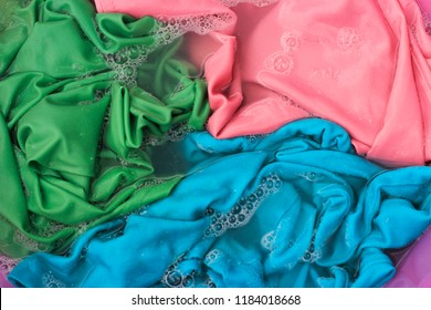colorful Clothes in a wash basin close-up, background