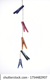 Colorful clothespin clothespins on the hangers. Plastic and wooden clothespins in different colors