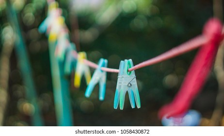 Colorful  clothespin clothespins on the rope...