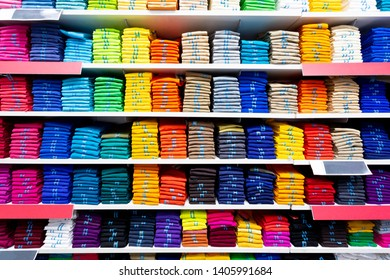 Colorful clothing neatly on shelves