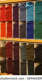 Colorful cloths on the wooden shelf