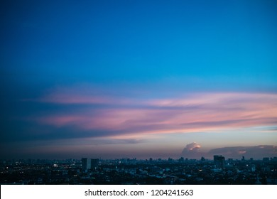 Colorful cloud and sky sunset over cityscape.