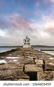 Colorful Clouds Above The Rockland Harbor Breakwater Lighthouse in Maine