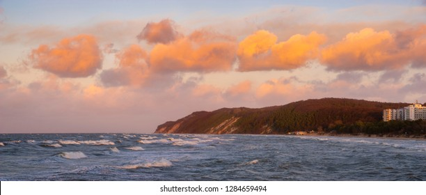 colorful clouds of the Baltic Sea at sunset in winter. Miedzyzdroje, Poland