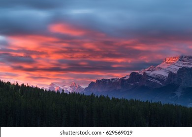 Colorful clouds at sunrise with close up of Mount Rundle in Banff National Park, Alberta, Canada