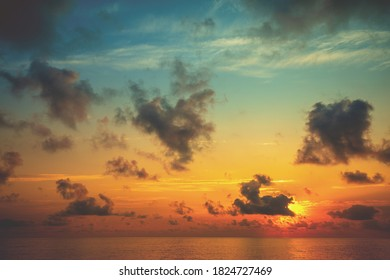 Colorful cloudy sky over the sea during sunrise. Seascape in early morning. Sunrise in the sea. View of the sea with beautiful colorful cloudy sky