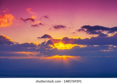 Colorful cloudy sky at sunset. Pink purple gradient color. Abstract nature background. Sunset sky texture