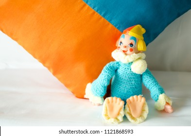 colorful clown doll lay down on the bed