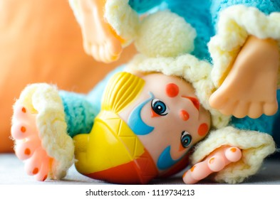 colorful clown doll somersault on the bed and smile