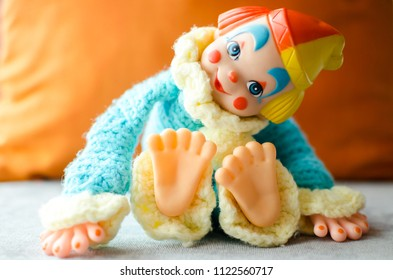 colorful clown lay down and smile on the bed