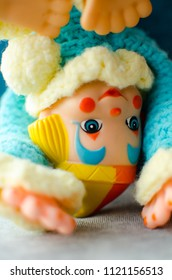 colorful clown somersault on the bed in selective focus