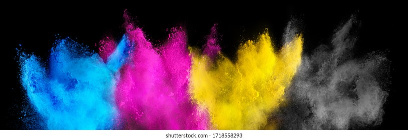 colorful CMYK cyan magenta yellow key holi paint color powder explosion isolated on dark black background. printing print business industry manufacturing  beautiful party festival concept