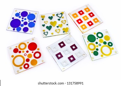 Colorful coasters for glass isolated on white