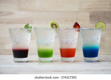 Colorful cocktail drink on wood table