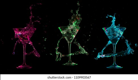 colorful cocktail in glass with splashes on dark background. Party club entertainment. Mixed light