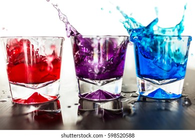 Colorful cocktails in glasses with splash