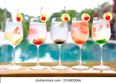 colorful cocktails on pool bar background