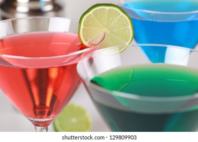 Colorful Cocktails such as Cosmopolitan, Blue Curacao and Martini in glasses