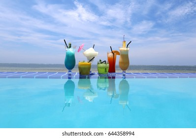 Colorful coctails by the swimming pool