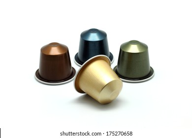 Colorful coffee capsules isolated on white background