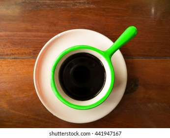 Colorful coffee cup set on brown wood table