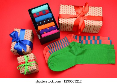 Colorful collection of cotton socks as a gift in woman hands.